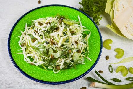 Cabbage Coleslaw Salad with Pumpkin Seeds. Selective focus.