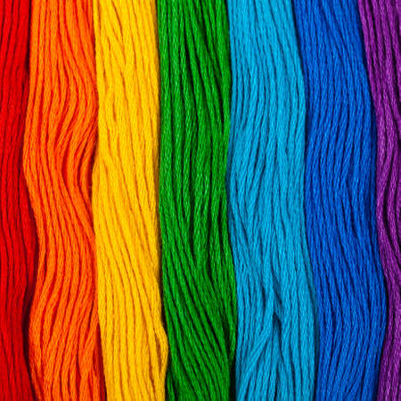 Colorful Embroidery Floss Background. Selective focus.