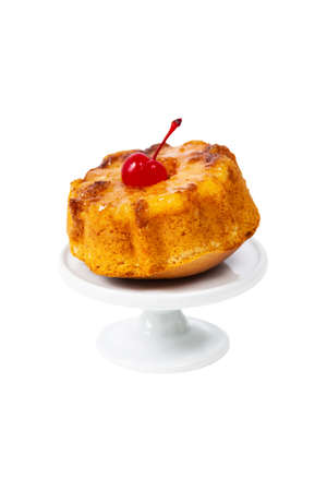 Pineapple Upside Down Muffins Cake Isolated on White Background. Selective focus.