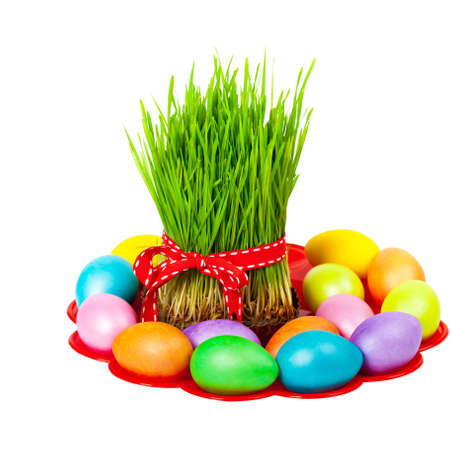 Colored eggs, wheat springs on Nowruz holiday on white background. Selective focus.