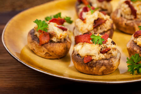 portobello: Stuffed Mushrooms with Breadcrumbs, Cheese and Bacon. Selective focus. Stock Photo