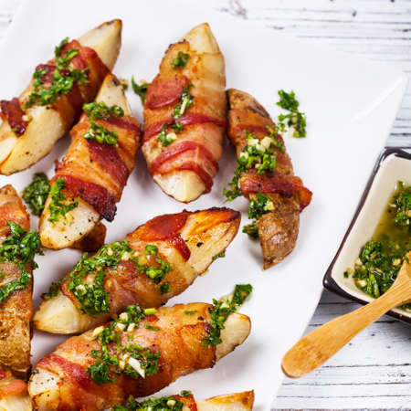Bacon Wrapped Potatoes with Parsley Garlic Pesto Sauce. Selective focus.