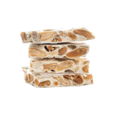 Nougat Turron Crunchy Almond Isolated on White Background. Selective focus.