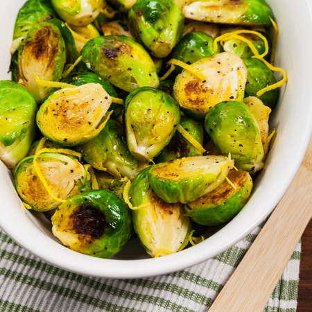 Brussels Sprouts Cabbage With Lemon. Selective focus. Stock Photo