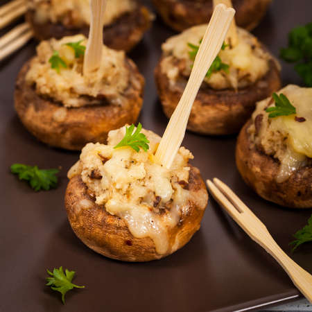 portobello: Stuffed Mushrooms with Breadcrumbs and Cheese. Selective focus. Stock Photo