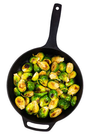 sauteed: Brussels Sprouts Cabbage With Lemon Isolated on White background. Selective focus.