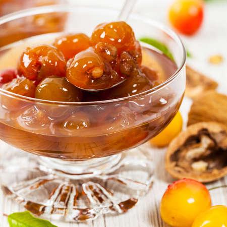 Cherry Jam with Nuts. Azerbaijani Cuisine White Cherry Preserves. Selective focus.