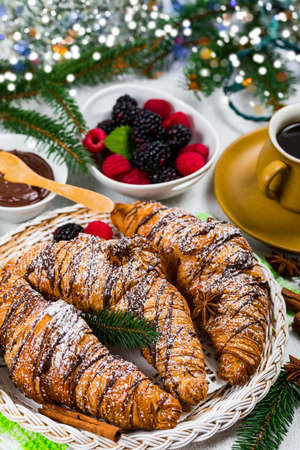 Chocolate Croissants for Breakfast with Christmas Theme Background. Selective focus.