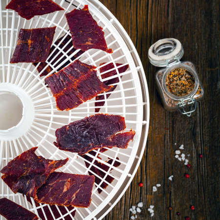 Homemade Beef Jerky in a Dehydrator. Selective focus. Archivio Fotografico