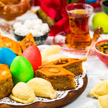 Colored eggs, wheat springs and sweet pastry for Nowruz Holiday in Azerbaijan. Selective focus. Stok Fotoğraf