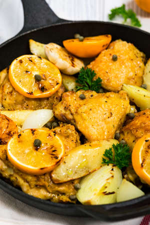 Chicken Thighs Roasted with Meyer Lemon and Potatoes. Selective focus. 写真素材
