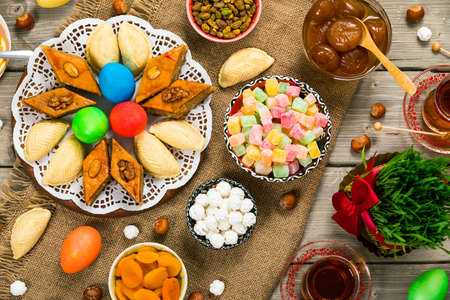 Novruz Ramadan in Azerbaijan. Colored Eggs, Wheat Springs for Easter and Traditional Sweets. Selective focus. Stok Fotoğraf