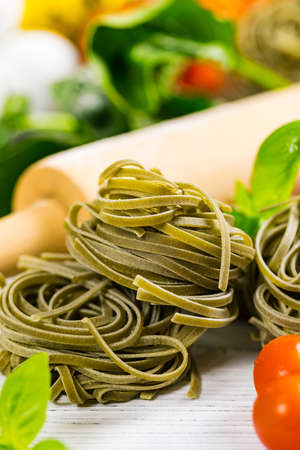Spinach and Basil Pasta Nests Background. Selective focus.