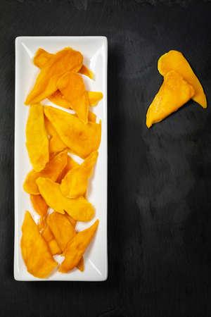 Dried Mango Fruit on Black Background. Selective focus.