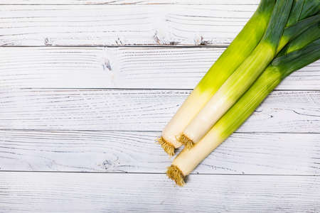 Leek Green Onion on Wooden Background. Selective focus. 写真素材