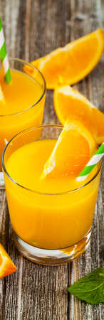 Orange Juice on Wooden Background. Selective focus.
