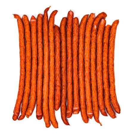 Kabanos or Cabanossi Thin Dry Smoked Polish Sausage Isolated on White background. Selective focus.