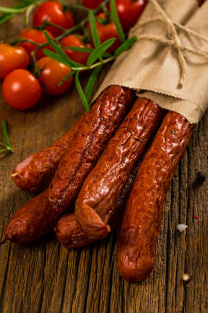Kabanos or Cabanossi Thin Dry Smoked Polish Sausage Background. Selective focus.