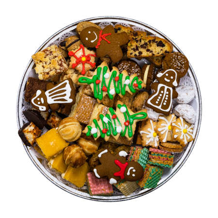Christmas Cookies Background with Assorted Mixed Cookies Variety Flavors Isolated on a White Background. Selective focus.