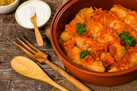 Russian Stuffed Cabbage Rolls on Wooden Background. Selective focus.