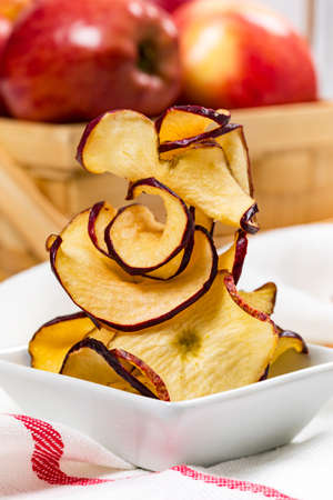 Baked Cinnamon Red Apple Chips. Selective focus.