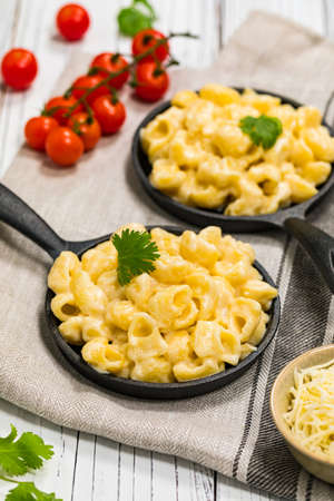 Macaroni and Cheese Old Fashioned Skillet on Wooden Background. Selective focus. 写真素材