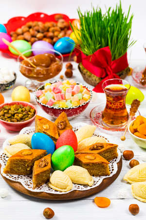 Colored Eggs, Wheat Springs for Easter and Traditional Sweets for Navruz Ramadan in Azerbaijan. Selective focus. 写真素材