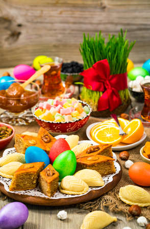 Novruz Ramadan in Azerbaijan. Colored Eggs, Wheat Springs for Easter and Traditional Sweets. Selective focus. 写真素材