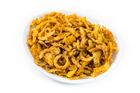 Crispy Fried Onion Strings with Garlic and Pepper Isolated on White Background. Selective focus.