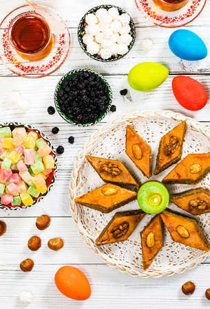 Colored Eggs, Wheat Springs for Easter and Traditional Sweets for Novruz Ramadan in Azerbaijan. Selective focus.