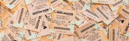 Used Mega Millions, FANTASY 5, POWERBALL, DAILY 4 American Lottery Game Ticket Background. Selective focus.