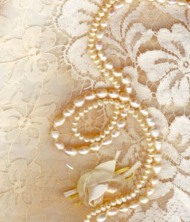 Wedding background with cream silky decoration accessories, lace and pearls Stock Photo