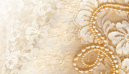 wedding accessories: Wedding background with cream silky decoration accessories, lace and pearls with copy space for your text