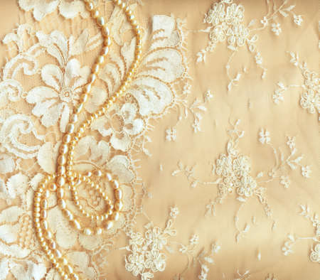 bead embroidery:  Wedding background with cream silky decoration accessories, lace and pearls Stock Photo