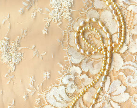 Wedding background with cream silky decoration accessories, lace and pearls photo