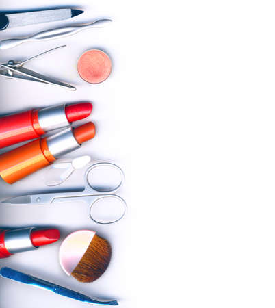 facial: makeup brush and cosmetics, on a white background isolated