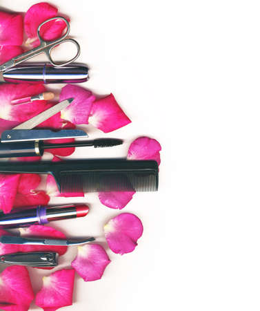 makeup brush and cosmetics with rose petals, on a white background isolated  photo
