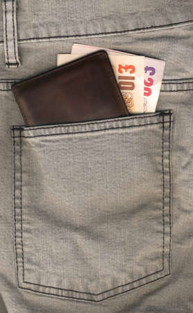 bolsa dinero: El dinero en el bolsillo Foto de archivo