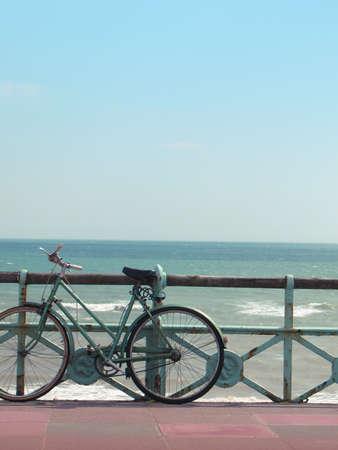 brighton beach: A vintage beach bike against turquoise sea.