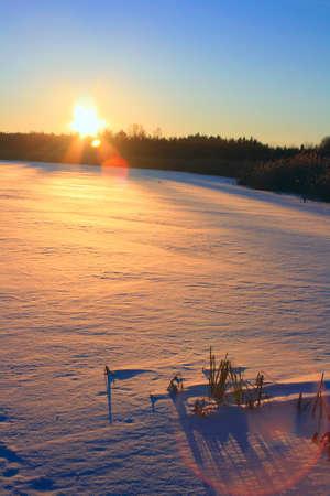 boldino: Winter sunset. Frozen lake Stock Photo