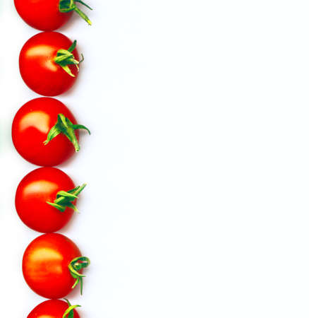 tomatos:  A line of red organic cherry tomatoes Stock Photo