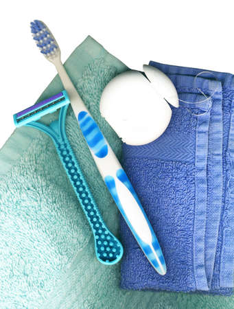 Toothbrush, with floss and towels on a white background  Stock Photo