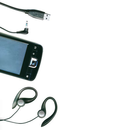 A collection of different electronic cables and pda on a white background, isolated photo