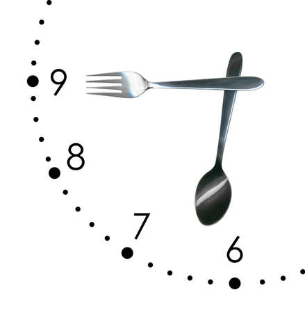Clock made of spoon and fork, isolated on white background photo