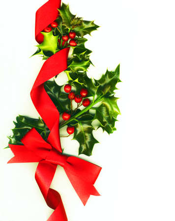 Christmas decoration with holly and ribbons photo