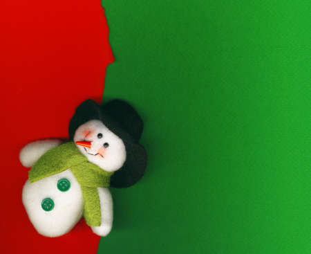 Snowman on paper background photo