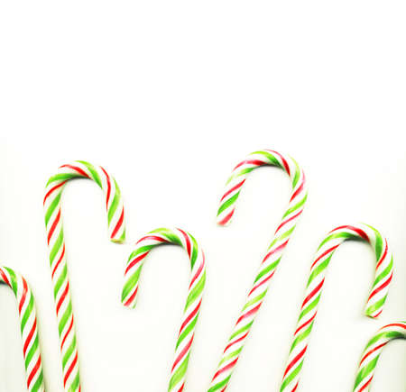 Four red and green Christmas candy canes isolated on white  photo