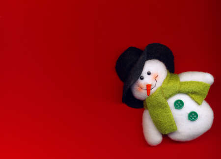 Snowman on red background photo