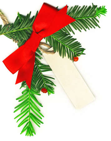 Christmas border with white empty tag isolated on white background photo