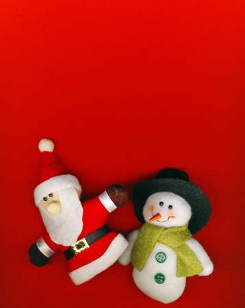 Santa Claus and snowman on the red Christmas background
